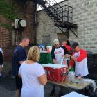 Jay Freund and Mike Bergmann pouring beer at Rally to The ALLey